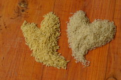 Two hearts made from rice. Rice, love, heart, reis, arroz, riso, riz, рис, liebe, amor, amore, amour, любо́вь Royalty Free Stock Photography
